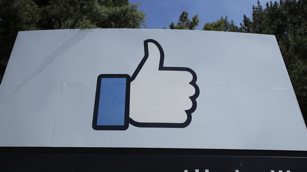 The thumbs up Like logo is shown on a sign at Facebook headquarters in Menlo Park, Calif.