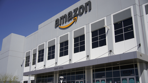 A worker walks out of an Amazon warehouse in North Las Vegas on March 31.